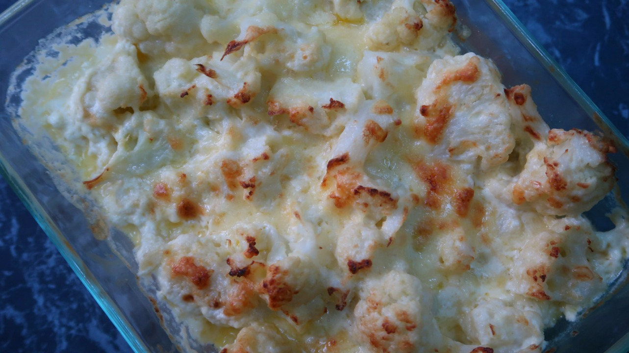 Dish with freshly baked cheesy low carb cauliflower casserole