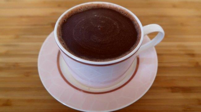 Almond milk hot chocolate in a pink mug